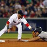 Boston's Dustin Pedroia tags out New York's Matt Holliday trying to stretch a single into a double during the seventh inning of Thursday night's game at Fenway Park in Boston. The Yankees won 3-0.