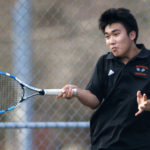 Brunswick number one singles Dasol Kim returns the ball to Bangor's Dennis Stewart during their tennis match at Bangor Friday.