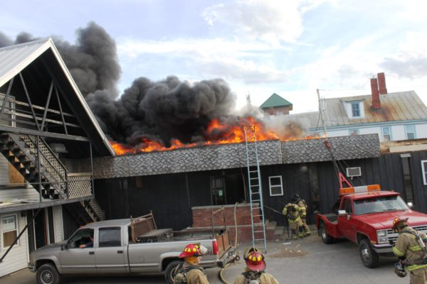 Apartment Building Roof chain saw fuel leak sparks waterville office, apartment fire — mid