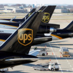 United Parcel Service air craft are being loaded with air containers full of packages in Louisville, Kentucky, Dec. 3, 2015.