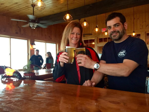 Jennifer and Nick Charboneau make a toast in Cook's Lobster and Ale House.