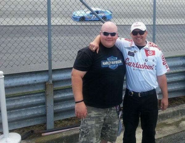 Matt Benjamin (right) of Morrill poses alongside friend Jeff Frye at the Monster Mile, Dover International Speedway in Delaware. Benjamin is a mechanic for Kyle Larson.