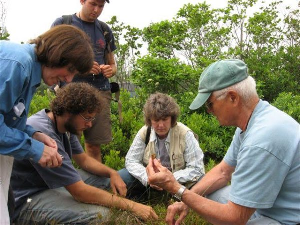 Fred Olday of Columbia, far right, leads a class on bryophytes at Eagle Hill Institute in Steuben.