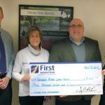 Pictured left to right are Tim Wooster, First Advisors; Debbie Rogers, GRLT Garden Tour Chair; Jake Miller, First National Bank; and Megan Williams, Georges River Land Trust.