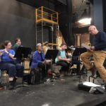 Visiting artist Rinde Eckert (right) works with students during a rehearsal.