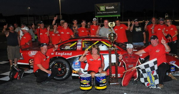 Trevor Pollard of Searsmont (back row, right, black shirt), shown celebrating Travis Benjamin's Oxford 250 with crew members, family and friends in 2013, is now working as truck chief for GMS (Gallagher Motor Sports) Racing in North Carolina.