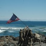 A reenactment of a flag raising at Iwo Jima at the beach cliffs near the Marginal Way walkway in Ogunquit on Sunday morning.