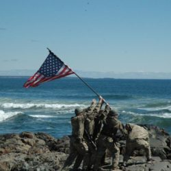 A reenactment of a flag raising at Iwo Jima at the beach cliffs near the Marginal Way walkway in Ogunquit on Sunday morning.