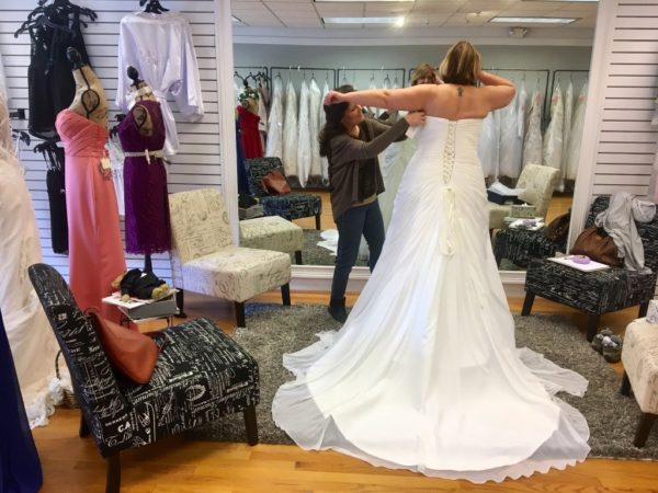 Corinne Desruisseaux of Tenants Harbor will marry Rodney Royer of Rockland in a traditional wedding on May 21 at the Point Lookout Resort in Northport. Here, her gown is fitted at Somebody Loves Me Bridal in Rockland.