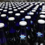 Bottles of Bud Light Platinum move along during the packaging process at Anheuser-Busch brewery, July 3, 2013, in downtown St. Louis, Missouri.