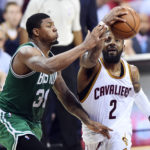 Cleveland Cavaliers guard Kyrie Irving (2) drives to the basket against Boston Celtics guard Marcus Smart (36) during the second half in game four of the Eastern conference finals of the NBA Playoffs at Quicken Loans Arena.