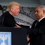 U.S. President Donald Trump (L) embraces Israel's Prime Minister Benjamin Netanyahu before his remarks at the Israel Museum in Jerusalem, May 23, 2017.