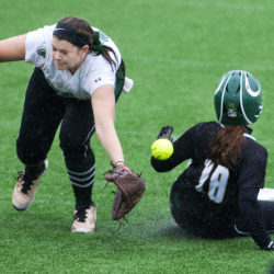 Castleton University's Sara Baker (left) misjudges a throw to second allowing Husson University's Bri Brochu to slide safely to the base during their North Atlantic Conference softball championship tournament game at Winkin Stadium in Bangor on May 6.