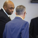 "Thomas ""Ferg"" Ferguson (left) talks to his attorney Jeffrey Silverstein during the beginning of Ferguson's trial at the Penobscot Judicial Center."