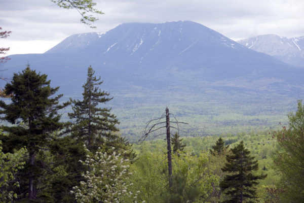 The monument offers a spectacular view of the mountains of Baxter State Park, but few saw them from inside the federal land on Thursday. National Park Service officials hope for a better showing this weekend.