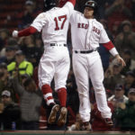 Boston's Deven Marrero (17) celebrates with teammate Christian Vazquez (7) after his two-run home against Texas in the eighth inning of Thursday's game at Fenway Park.