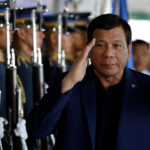 Philippine President Rodrigo Duterte salutes the honor guards upon arrival from Russia at the Ninoy Aquino International airport in Paranaque, Metro Manila, Philippines May 24, 2017.