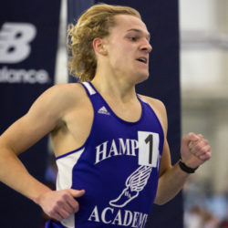 Hampden Academy's Paul Casavant takes the lead in the mile run during the PVC-Eastern Maine Indoor Track League Championship meet at the University of Maine in Orono.