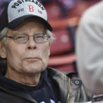American author Stephen King of Bangor, Maine, takes in the game between the Boston Red Sox and Seattle Mariners at Fenway Park in Boston on Friday night. The Red Sox won 3-0.