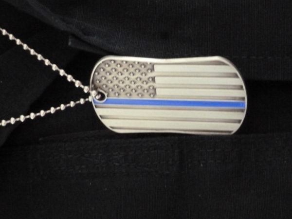 Old Town Police Chief Scott Wilcox wears as Blue Line dog tag. Every police officer in Penobscot County in May was given one for National Law Enforcement Appreciation Week.
