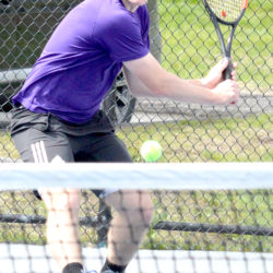 John Bapst's Paul Branch returns a shot to Morse High School's Thomas Jarmusz during their match in the Round of 16 at the MPA singles tennis tournament at Colby College in Waterville on Saturday. Branch fell to Jarmusz in three sets.