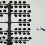 A British Airways plane flies over the Oval Cricket ground.