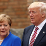 President Donald Trump and German Chancellor Angela Merkel pose during a family phto at the Greek Theatre during a G7 summit in Taormina, Sicily, Italy, May 26, 2017.