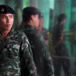 A Thai soldier stands guard near the area of the bomb blast at Phramongkutklao Hospital in Bangkok, Thailand, May 22, 2017.