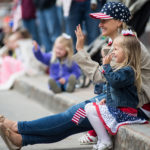 Hannah Lowe, 4, and her mom, Jennifer of Brewer, wave at veterans passing by in the Greater Bangor Area 2017 Memorial Day Parade Monday morning.