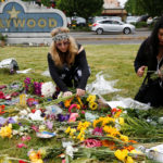 Portland residents Sedona Soulfire, 41, left, and Kat Ablola, 38, arrange flowers at a makeshift memorial for two men who were killed on a commuter train while trying to stop another man from harassing two young women who appeared to be Muslim, at the Hollywood Transit Station in Portland, Oregon, U.S. May 29, 2017.