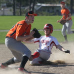 Ryan Player of Fort Fairfield slides safely into third base as Will Whitman of Limestone Community School/Maine School of Science and Mathematics prepares to field the throw during a May 16 game at Fort Fairfield.