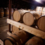 Wiggly Bridge Distillery spirits age in oak barrels beneath a barn on Route 1 in York.