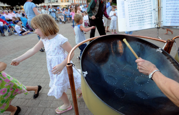 Ann Durgin (right) plays with the Blue Hill-based Flash in the Pans steel drum group as children and adults dance to the music in Pickering Square in Bangor, June 12, 2008.