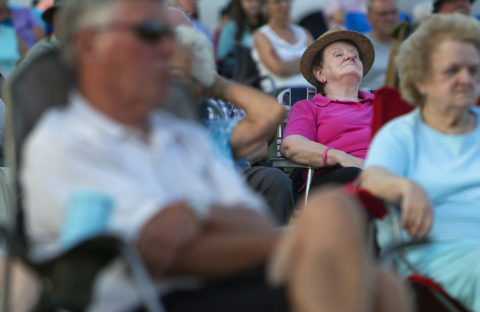 Judith Brosmer enjoys the music while listening to the Bangor Band performs during the Summer Concert at the Waterfront, July 12, 2016.
