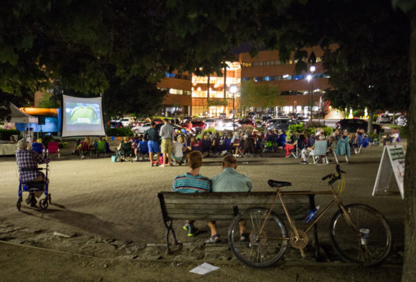People gather in Pickering Square in Bangor to watch a free, public showing of the movie &quotSay Anything,&quot presented by River City Cinema as part of its &quotSummer of Love,&quot July 24, 2016.