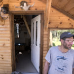 Vinny Marotta bought five acres of land in Thorndike a few years ago hoping to build a small house without going into debt. He cleared a patch of forest, landscaped a portion of it and as he had money he built a 10-by-10 foot building, often using repurposed materials.