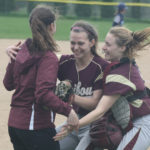 Pitcher Rachel Soucy (center) and catcher Jaelynn Doody (right) celebrate with coach Kayla Richards after Caribou defeated Presque Isle, 5-4, on Wednesday in Caribou.