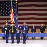 Members of the Maine Select Honor Guard prepare to post the colors at the 26th Annual Interfaith Prayer Breakfast hosted by the Maine National Guard at the Augusta Armory.  Governor Paul R. LePage and the Adjutant General for the Maine National Guard, Brig. Gen. Douglas A. Farnham stand behind the honor guard to pay respect to the state and national colors. (Maine Army National Guard photo by Staff Sgt. Angela Parady.)