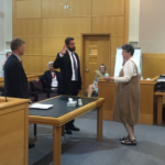 Anita Alexander (right), clerk of courts in Sagadahoc County, swears in Jonathan Liberman (center) as deputy district attorney for Knox, Lincoln, Sagadahoc and Waldo counties while District Attorney Geoffrey Rushlau looks on in West Bath, July 18, 2016.
