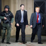 Former North Charleston police officer Michael Slager is escorted from the courthouse by security personnel while waiting on his verdict at the Charleston County Courthouse in Charleston, South Carolina, U.S., December 5, 2016.