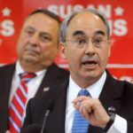 Former state treasurer Bruce Poliquin speaks at a ralley for Republican politicians who are running for reelection or office at Husson University in Bangor Friday morning. Poliquin is running for the 2nd District seat in Congress. On the left is Gov. Paul LePage. Gabor Degre | BDN