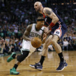 Boston Celtics point guard Isaiah Thomas (4) drives against Washington Wizards center Marcin Gortat (13) during the fourth quarter in game two of the second round of the 2017 NBA Playoffs at TD Garden. Mandatory Credit: Greg M. Cooper-USA TODAY Sports