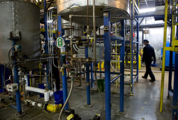 A Biofine worker makes notes of the machinery during at the University of Maine Technology Research Center in Old Town Wednesday. The Massachusetts company Biofine demonstrated its pilot biorefinery project in the former Old Town Fuel and Fiber mill.