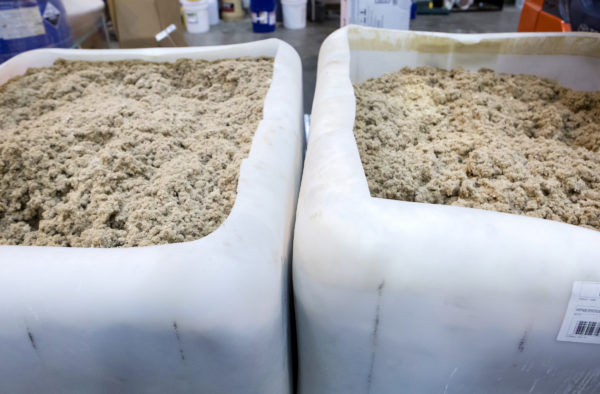 Containers of paper pulp wait to be refined at the University of Maine Technology Research Center in Old Town Wednesday. The Massachusetts company Biofine demonstrated its pilot biorefinery project in the former Old Town Fuel and Fiber mill.