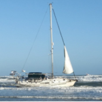 A sailboat owned by Clearwater, Florida resident Richard Tomlinson, 82, was en route to Maine when something happened and the vessel was found beached on Monday near the tip of the barrier island of Hatteras Island.