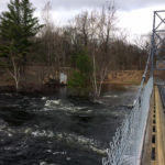 The West Branch of the Penobscot River overflows into a parking lot near the Brian Wiley Multi-Use Recreational Bridge off Route 11 just west of Millinocket on Wednesday.