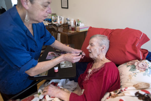 Ann Leffler, 70, administers a cannabis tincture while caring for her spouse, Dair Gillespie, 77, at their home in Orono. Gillespie, who has advanced Alzheimer's disease, is among the first Mainers to be certified to use marijuana to treat the symptoms of Alzheimer's.