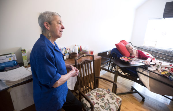 Ann Leffler (left) has been caring for her spouse, Dair Gillespie, at their home in Orono. Gillespie, who has advanced Alzheimer's disease, is among the first Mainers to be certified to use marijuana to treat the symptoms of Alzheimer's.