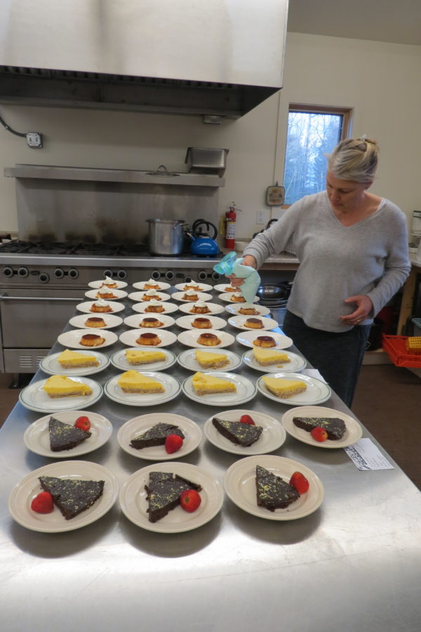 Rebecca House of Orland puts the finishing touches on some of the desserts available at the Halcyon Grange No. 345's Music & Pie night on Friday, April 29, at the Blue Hill grange hall.