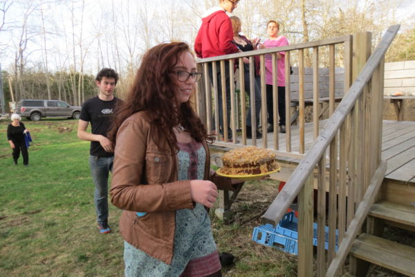 Maya Ibarguen of Surry delivers a cake to the Halcyon Grange for the Music & Pie night held Friday, April 29.